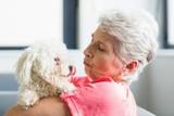 Senior woman holding a dog