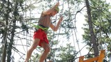 Man climbing the trees in Adventure Park