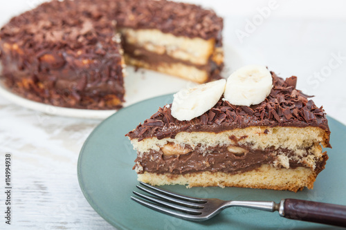 fototapeta na ścianę Chocolate cake with fresh banana