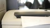 Paper shredder destroys pages, 4k UHD 2160p, dolly slider shot