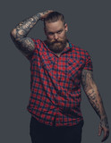 Tattooed male in a red shirt.