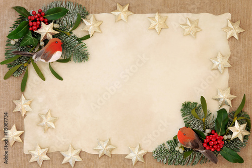 Poster Christmas decorative background border with gold star and robin decorations, holly, ivy, mistletoe, snow covered  fir over old parchment and hemp paper