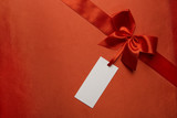 Silk Fabric Background, Red Satin Ribbon Bow, Price Tag