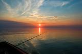 angeln beim sonnenuntergang