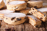 """British biscuits: Welsh cakes with raisins and powdered sugar close-up. horizontal 115126692,3d illustration of wax seal or stamp and from Brittany with love message"""""""