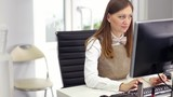 Businesswoman in office working with computer