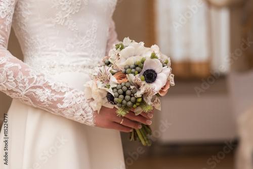 beautiful wedding bouquet in hands of the bride © IrBreeze