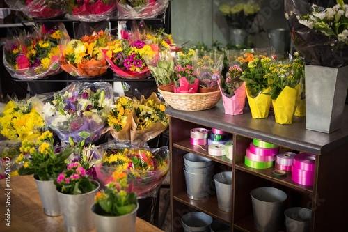 Flower vase arranged on a wooden worktop