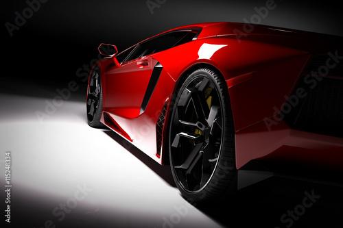 Czerwony szybki sporta samochód w świetle reflektorów, czarny tło. Błyszczące, nowe, luksusowe.