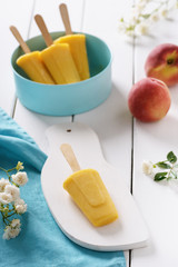 Homemade popsicles made with peaches. Summer dessert. Selective focus.