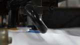 Sprocket chain on sheet offset machine draws paper in printery
