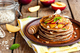 Pancake with poppy seeds and peaches