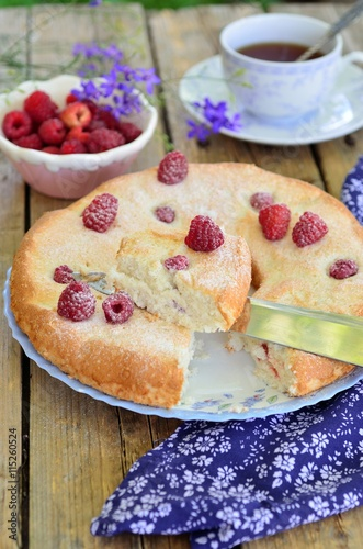 obraz PCV Cake with raspberries on a wooden background.