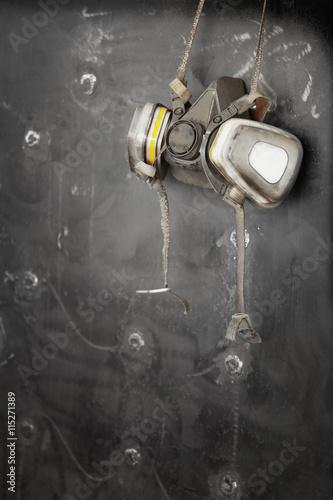 Poster Respirator hanging on metal surface