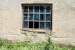 window in wall of abandoned building - 115288799