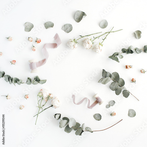 Staande foto Roses empty wreath frame with roses, eucalyptus branches, leaves and spool with ribbon isolated on white background. flat lay, overhead view