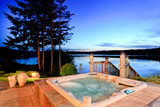 Awesome water view with hot tub at dusk in summer evening. - 115312146