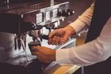 Fototapety Waiter using coffee machine