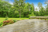 View of wooden walkout deck with patio area. - 115315362