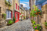 Fototapety Idyllic scene of traditional houses in narrow alley in an old town in Europe