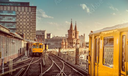 Zdjęcia na płótnie, fototapety na wymiar, obrazy na ścianę : Berlin trains with Oberbaum Bridge at sunset, Berlin Friedrichshain-Kreuzberg, Germany