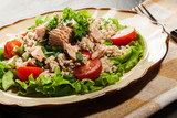 Tasty salad with couscous, tuna and vegetables