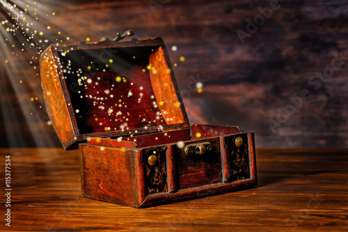 Poster beautiful greeting card of opened vintage chest treasure with mi