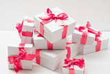 gifts.  white boxes with pink ribbon