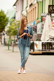 Young stylish woman with headphones and phone.