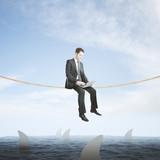 Risk concept businessman above sharks