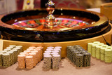 Close up of wooden roulette and chips in casino, selective focus - 115455767