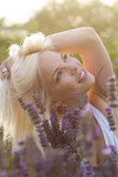 beautiful blonde woman in the lavender field on sunset - soft focus