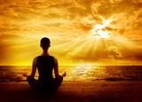 Fototapety Yoga Meditating Sunrise, Woman Mindfulness Meditation on Beach