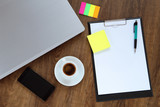 Office workplace with laptop, smart phone and coffee cup on wood table - 115463954