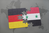 puzzle with the national flag of germany and syria on a world map background.