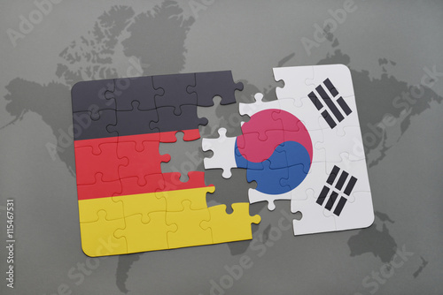 Poster puzzle with the national flag of germany and south korea on a world map background