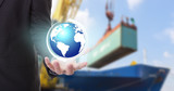 Earth globe in his hands of businessman concept of Industrial Container Cargo freight ship at harbor for Logistic Import Export background (Elements of this image furnished by NASA)