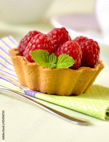 obraz PCV Fruit raspberry tarts on a table