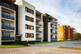 New multi-family block with balconies and bright facade decorated with wood paneling. - 115510533