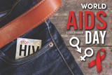 world aids day condom injeans back pocket with wooden table background, vintage tone