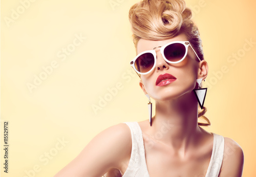 Fashion portrait Hipster Model woman, Stylish hairstyle. Fashion Makeup. Blond sexy Model, Trendy Glamour fashion Sunglasses. Playful cheeky fashion girl. Unusual Creative.Party disco mohawk hairstyle