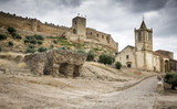 Medieval castle and Santiago church in Medellin Village, Badajoz, Spain