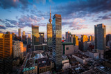 Fototapety View of modern buildings at sunset in downtown Toronto, Ontario.