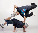 Dancers perform a couple nice trick to break dance