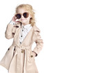 Fashionable child. Girl blonde with glasses