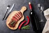 Grilled striploin steak and wine