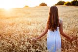 Beautiful woman in fields of barley