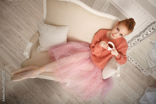 fototapeta na ścianę Ballerina drinking black tea and relax