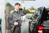Gas station attendant at work - 115698766