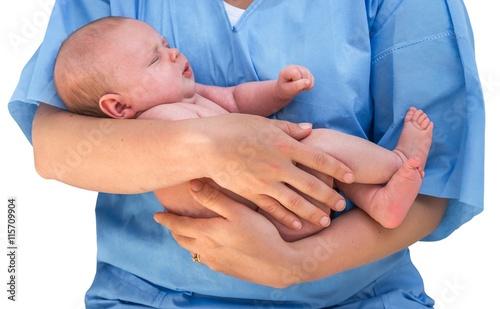 Doctor holding a beautiful newborn baby